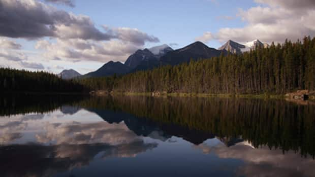 Parks Canada employees have received letters warning they're not allowed to criticize the agency or the federal government. The directive comes as the agency cuts hundreds of jobs or curtails work hours.