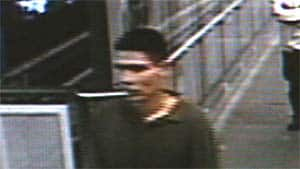 A man identified by transit police as a robbery suspect is seen entering Broadway Station in Vancouver.