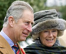 Prince Charles and Camilla, Duchess of Cornwall, pause during a tour of an archeological dig on Nov. 3, 2009, in Cupids, N.L.