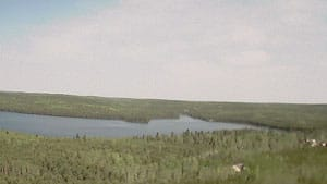 Lake 239, one of 58 lakes that make up the Experimental Lakes Area in northwestern Ontario, is seen in a webcam photo taken May 17. Funding for the research facility will end next March, the federal government has announced.