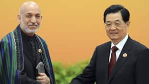Afghan President Hamid Karzai(left), seen here meeting with with Chinese President Hu Jintao, has criticized NATO for the airstrike.