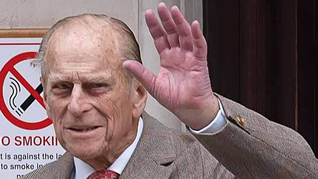 Prince Philip waves as he leaves King Edward VII Hospital in central London after being treated for a bladder infection.