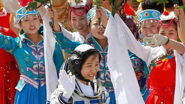 Liu Yang waves during a sending-off ceremony as she departs for the Shenzhou 9 spacecraft rocket launch pad in Jiuquan, China on Saturday.