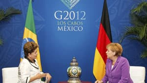 Brazilian President Dilma Rousseff, left, and German Chancellor Angela Merkel talk in a bilateral meeting in Los Cabos.