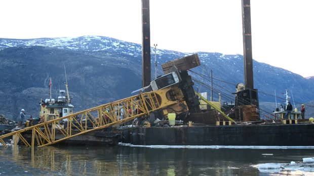 No one was hurt when a 120-tonne construction crane fell into the water in Pangnirtung in June. A new crane has been delivered and construction of the community's small craft harbour has resumed.