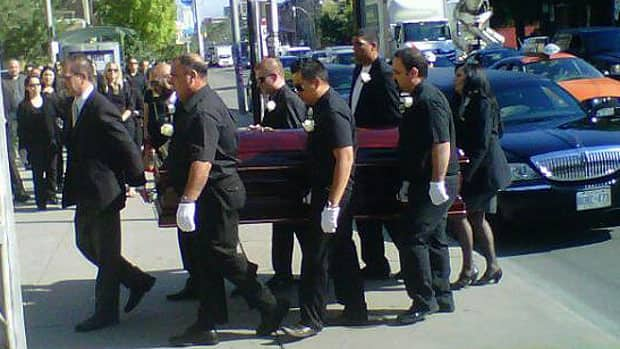 Funeral services were held Friday for John Raposo who was shot and killed in Toronto's Little Italy.