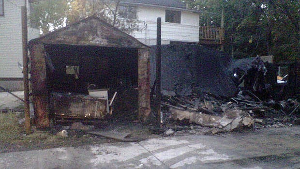 Fire destroyed this garage on Furby Street, as well as its contents and adjacent fence, on Wednesday.
