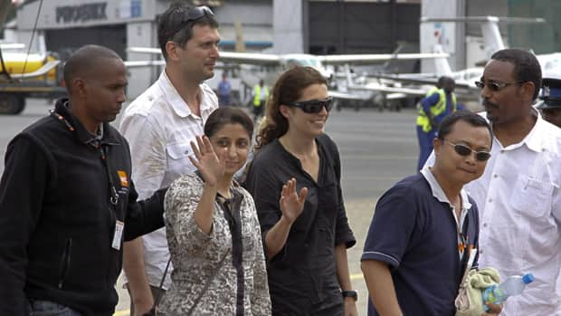 Released aid workers at a Nairobi airport are: second from left, Steven Dennis of Canada; Qurat-Ul-Ain Sadazai, a Canadian citizen of Pakistani origin; Astrid Sehl of Norway; and Glenn Costes of the Philippines.