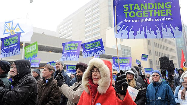Members of the Public Service Alliance of Canada demonstrate support for public services in Ottawa in March. Federal workers are starting to receive special payouts and raises to compensate for the loss of severance benefits.