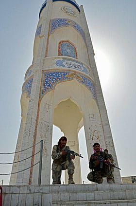 Afghan soldiers in Kandahar City watch over the funeral in July 2011, of Ahmed Wali Karzai, brother of the Afghan president, who was murdered in his home by an associate during Canada's watch.