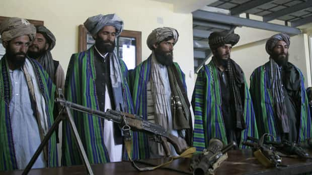 Former Taliban fighters hand over their weapons to Afghan police as part of a reconciliation process in Herat, Afghanistan, earlier this year. A veteran Taliban commander has said he doubts the insurgents can win.