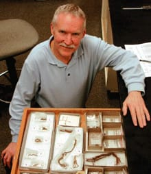 Dennis Jenkins, a University of Oregon archeologist, with some of the artifacts he and his team found at the Paisley Caves in 2008. That year, Jenkins and his colleagues uncovered evidence of human DNA dating to 14,300 years ago.