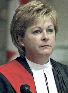 Lori Douglas, an associate chief justice of the Manitoba Court of Queen's Bench, has said she should not be penalized for her husband's actions.
