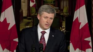 Prime Minister Stephen Harper shown making the announcement on April 9, 2010, that Helena Guergis had resigned from cabinet and that he was made aware of serious allegations about her conduct. Guergis is suing Harper for defamation.