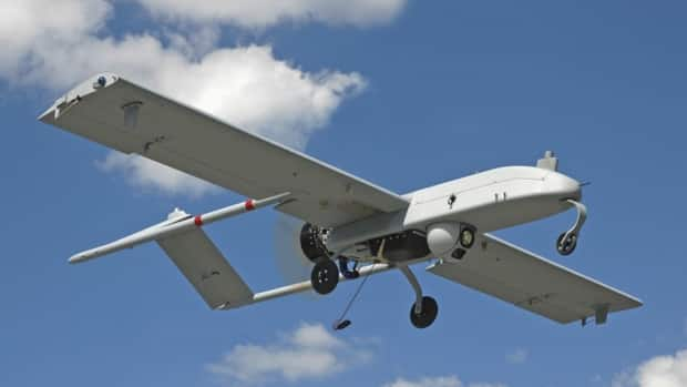 A U.S. military Shadow drone used for surveillance and reconnaissance is pictured in flight. U.S. officials are in the process of expanding regulations to allow the use of non-military drones in civilian airspace, but some lawmakers are warning that not enough attention is being paid to security and privacy implications of such a move.