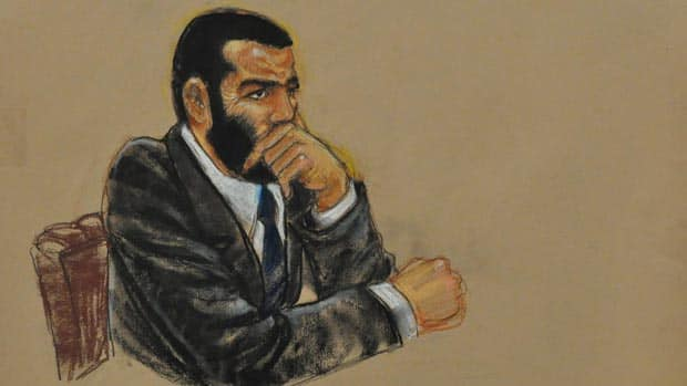 Omar Khadr listens to closing arguments at his trial on Oct. 30, 2010, at Guantanamo Bay in this court sketch.