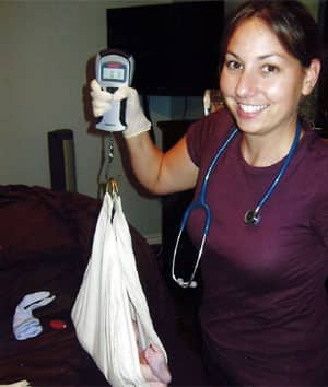 Leah Hackett, seen here weighing a newborn, is a member of the group that applied to have the birthing centre in Ottawa.
