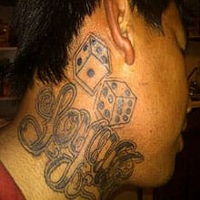 Dallas McKay has a large tattoo, featuring a pair of dice, on his neck.
