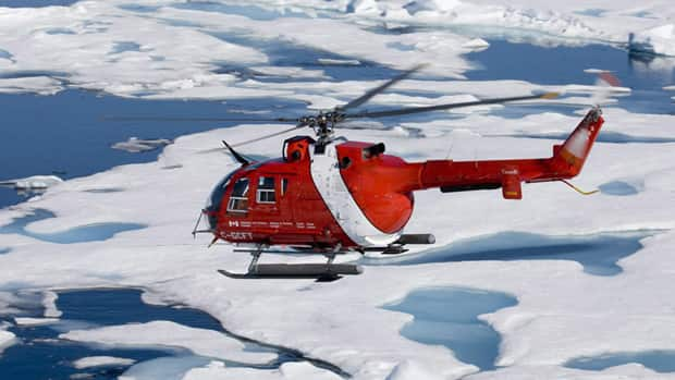 A Canadian Coast Guard helicopter flies over Baffin Bay during a patrol of the Northwest Passage in 2008. (The Canadian Press)