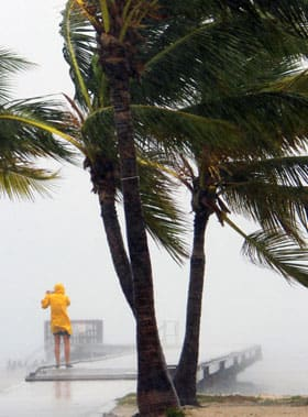 Some people braved the rain, including this person at Clarence Higgs Beach in Key West, Fla., as tropical storm Isaac hit the area on Sunday.