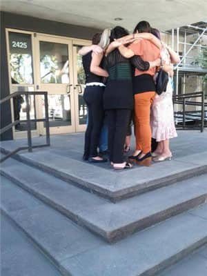 Family of the dead child embrace on the steps of the courthouse in Regina.