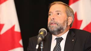 NDP Leader Tom Mulcair said Wednesday that the minority government win by the Parti Quebecois will delay his party's plans to start a provincial wing in the province.