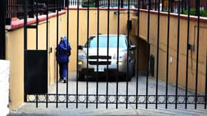 Embassy staff back a van into the underground garage at the Iranian Embassy in Ottawa. Canada has closed its embassy in Iran and is expelling all remaining Iranian diplomats in Ottawa.
