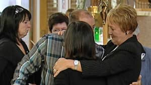 Quebec premier-designate Pauline Marois, right, attended and consoled mourners, including Blanchette's lifelong friend Denis Bourgault (face hidden at centre).