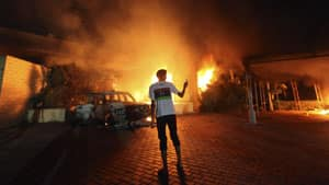 The U.S. diplomatic post in Benghazi, in eastern Libya, is seen in flames on Tuesday. Four Americans, including the ambassador, were killed in the deadly attack.