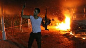 A man raises his rifle following an attack at the U.S. Consulate in Benghazi, Libya, which left four American diplomatic staff members dead.