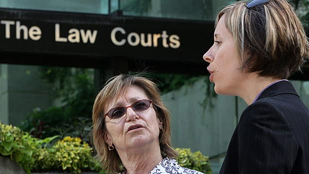 Former sex-trade worker Sheryl Kiselbach, left, and lawyer Katrina Pacey speak to the media in Vancouver in 2009. The Supreme Court of Canada is set to rule Friday on their bid to gain standing for sex-trade workers to challenge Canada's prostitution laws in B.C.