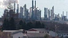Under the proposed changes, large industries, such as the Irving Oil refinery, would still require permits.