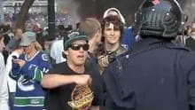 UBC student Andrew Peepre taunts a police officer during the Stanley Cup riot.