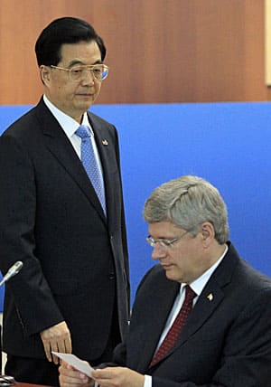 Chinese President Hu Jintao and Stephen Harper at the Asia-Pacific Economic Co-operation Summit in Vladivostok in September 2012, where a new bilateral trade agreement was announced.