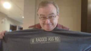 Ken Carson holds up the t-shirt which a WestJet flight attendant said violated the company's family-friendly policy.