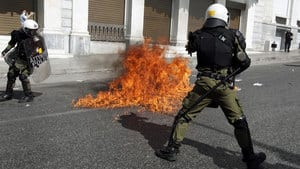 Protesters hurled rocks and petrol bombs at riot police in Athens on Thursday.