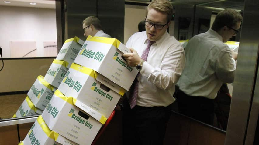 Attorney Peter Janci moves boxes full of records from the Boy Scouts of America, which  released 20,000 pages of documents the organization kept on men suspected of committing child abuse.