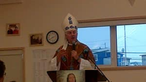 Bishop Murray Chatlain leads the mass and rosary at St. Kateri Roman Catholic church in Dettah, N.W.T., in October celebrating the canonization of the saint.