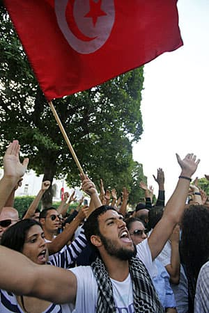 Members of Tunisia's secularist parties rally in Tunisia in October 2012, on the anniversary of historic elections that brought an Islamist government to power.