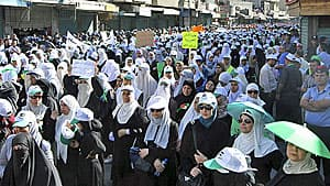 Thousands of women, supporters of the Islamic Action Front, march in Amman, Jordon, earlier this month, demanding more political reforms.