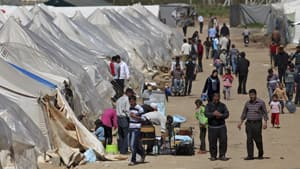 Syrians refugees who fled violence in their country are seen in a camp near Reyhanli, Turkey. A Canadian charity has helped set up a school in Reyhanli where children are bused every day.