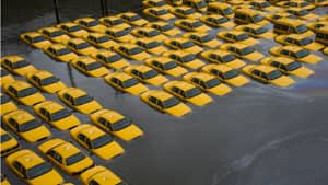 A parking lot full of yellow cabs is flooded as a result of superstorm Sandy on Tuesday in Hoboken, NJ.