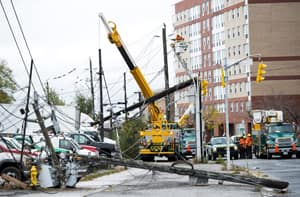 Toronto Hydro workers overlook the damage Tuesday as power lines were down after superstorm Sandy hit the city late Monday night causing power outages.