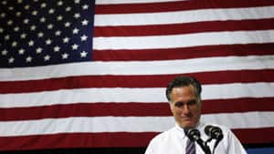 Republican presidential candidate Mitt Romney pauses while speaking at a campaign rally at The Patriot Center at George Mason University in Fairfax, Va.