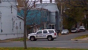 Halifax Regional Police say they saw a man in the aqua-coloured house holding a gun.