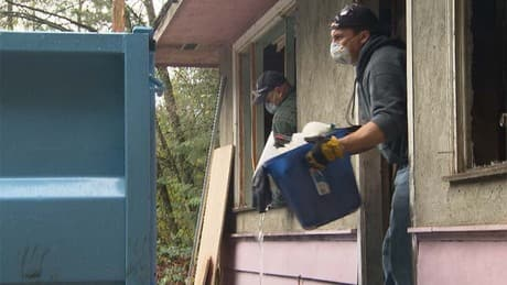 Burned out couple's home rebuilt by volunteers