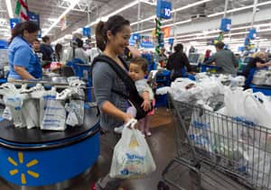 Americans take advantage of a pre-Black Friday event at a Walmart store in Rosemead, Calif. on Wednesday.