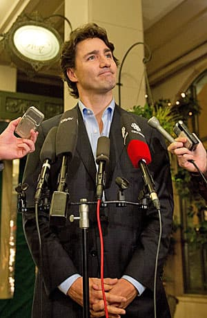 Justin Trudeau, at a media scrum in Vancouver on Friday. Says he is sorry for attacking Alberta when he really meant Stephen Harper.