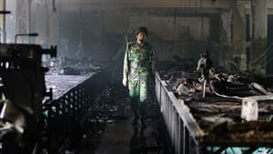 An army employee inspects the burnt interior of the factory in Savar.