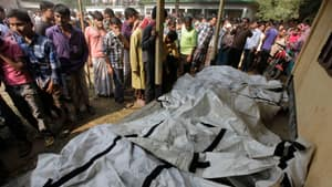 Bodies of dead garment workers are seen on the floor of a local school after the fire.